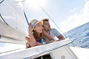 Couple,Laying,On,A,Sailboat,Deck,During,Cruise